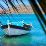 fishing-boats-off-the-coast-of-crete-mirabello-bay-greece-1436450593-zEhG-facebook@2x